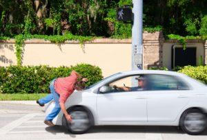 Car crashing into pedestrian on street